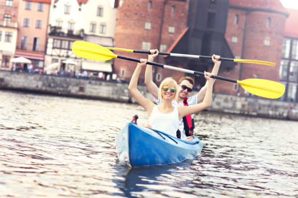 A picture of a young couple in a canoe sigtseeing Gdansk in Poland